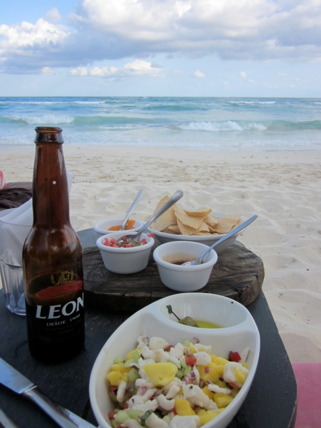 Beer and ceviche as I stare at the waves from my lounge chair